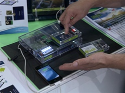 EPC engineers demonstrate the capabilities of the EPC9121 multi-mode wireless power charging kit at PCIM Asia 2016