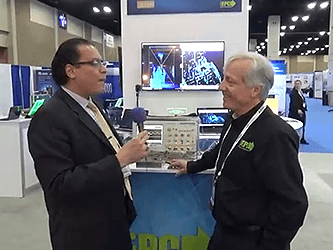 Alex Lidow walks Alix Paultre through the EPC booth at APEC 2018